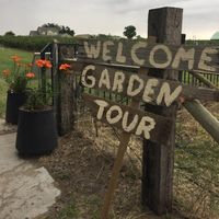 a sign says welcome garden tour