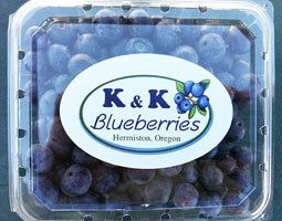 a plastic container of blueberries that says K and K blueberries on the front